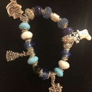 Pandora Bracelet with beads and charms.